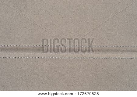 Close up of grey suede leather background