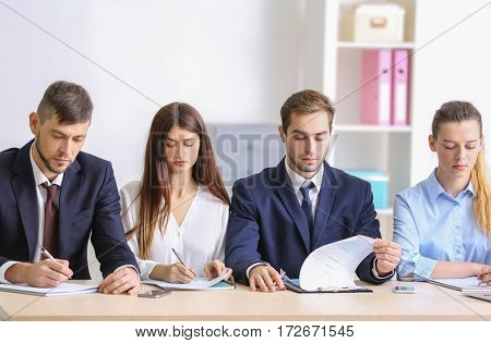 Group of interviewers during colloquy in office