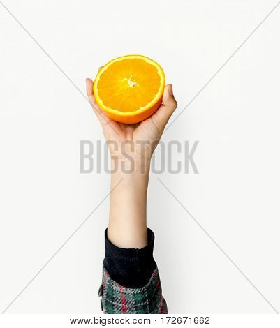 Hand Holding Orange Isolated Concept