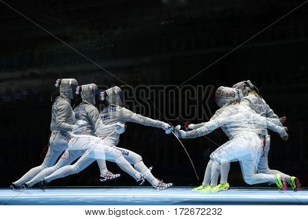 RIO DE JANEIRO, BRAZIL - AUGUST 13, 2016: Sofya Velikaya of Russia (L) and Mariel Zagunis of United States compete in the Women's Sabre Team of the Rio 2016 Olympic Games at Carioca Arena 3