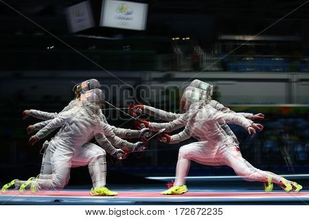RIO DE JANEIRO, BRAZIL - AUGUST 13, 2016: Team United States (L) competes against Team Poland in the Women's Sabre Team of the Rio 2016 Olympic Games at Carioca Arena 3