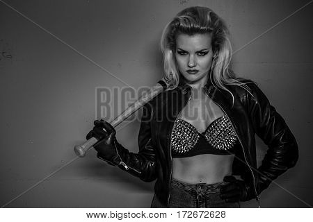 Beautiful and sexy blonde with a baseball bat