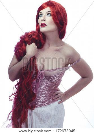 Healthy, Beautiful Spanish woman in lace dress and great red hair, romantic or medieval style