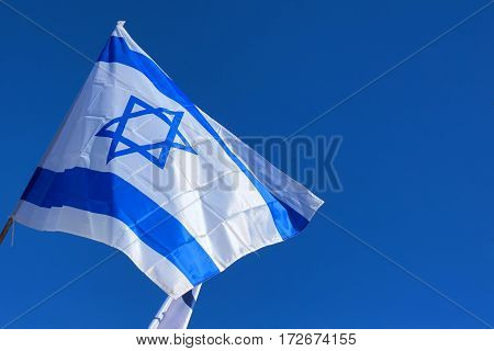 Close-up photo of white and blue flag of Israel