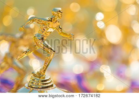 close up of track and field running trophy with shallow depth of field blurred foreground and background room for copy space