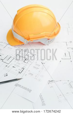 Architects workplace - architectural tools blueprints helmet measuring tape Construction concept. Engineering tools. Top view