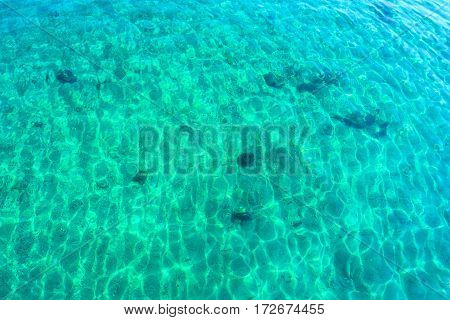 Turquoise water and surface of Aegean sea near Greek coastline