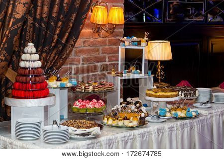Sweet table for a wedding. Colorful table with sweets for the wedding
