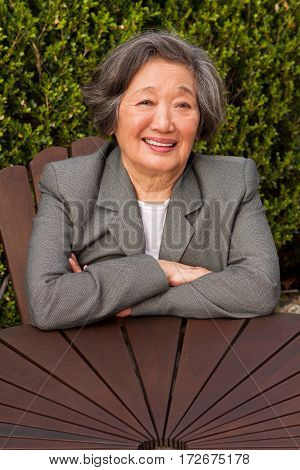 Happy mature Asian woman in her 70s.