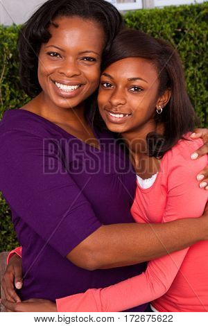 Loving African American mother and her daughter.