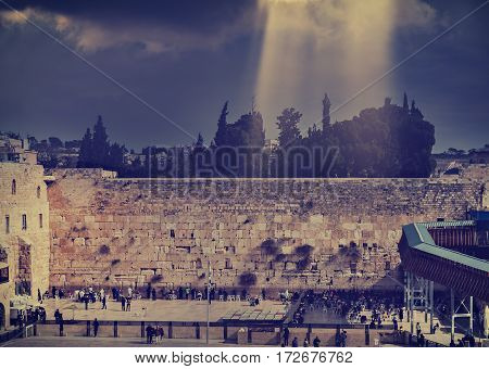 Ancient Ruins of Western Wall of Temple Mount is a major Jewish sacred place and one of the most famous public domain in the world, Jerusalem, Israel. Image toned for inspiration of retro style