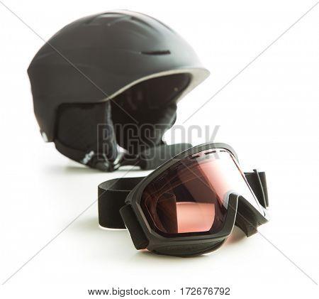 Ski glasses and helmet isolated on white background.