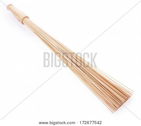 Bamboo massage stick  on a white background.   Spa, healthy lifestyle and relaxation concept.
