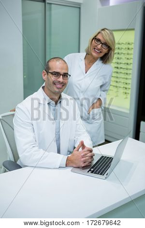 Portrait of smiling optometrists in ophthalmology clinic