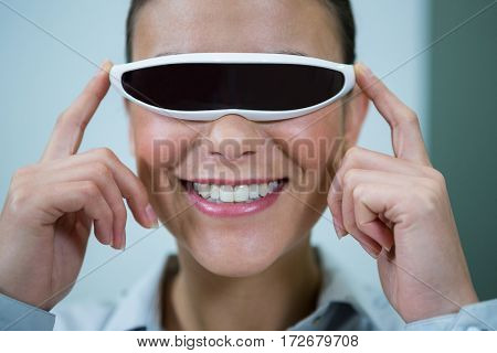 Woman using virtual video glasses in optical store