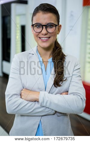 Portrait of optometrist in spectacles smiling in optical store