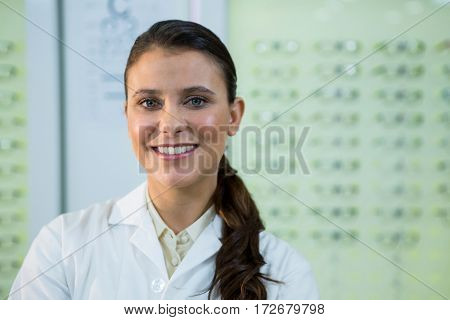 Portrait of optometrist smiling in optical store