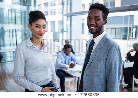 Portrait of smiling business colleagues standing in office