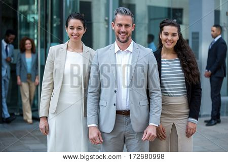 Portrait of smiling businesspeople standing in office building
