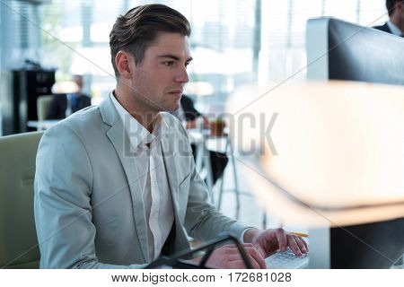 Businessman working on computer in the office