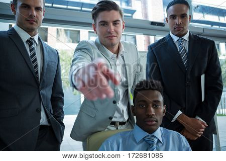 Businessman discussing work in office