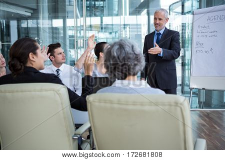 Businessman interacting with coworkers in office