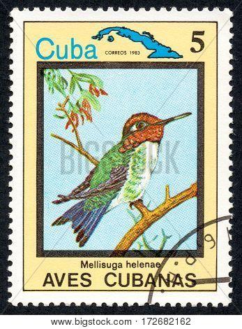 UKRAINE - CIRCA 2017: A stamp printed in Cuba shows the Hummingbird - bee Mellisuga helenae in a series of Cuban birds circa 1983