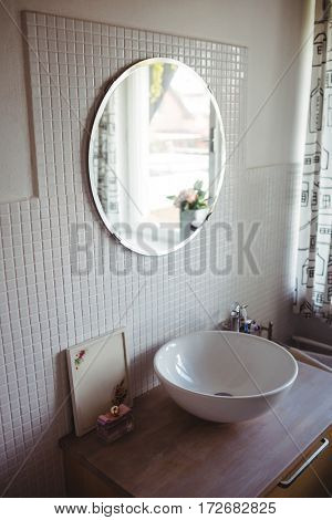 View of wash basin and mirror at bathroom