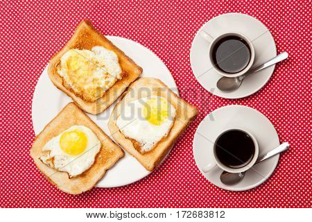 Two Cups Of Coffee And Toast, Egg On A Red Table
