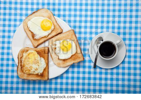 Breakfast. Cup Of Coffee, Toast And Eggs On A Blue Table
