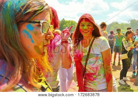 TULA RUSSIA - JUNE 13 2016: Young people at festival of colors Holi on June 13 2016 in Tula Russia