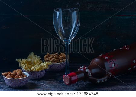 Ceramic Jug For Wine , Cheese, Nuts On A Wooden Board, Background.