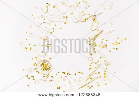 Beauty blog background. Gold style feminine accessories frame. Golden tinsel scissors pen rings necklace bracelet on white background. Flat lay top view.