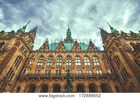 Beautiful view of famous Hamburg town hall with Hygieia fountain from courtyard near market square and lake Binnenalster in Altstadt quarter Hamburg Germany