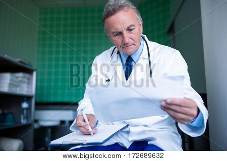 Doctor checking medical report at the hospital