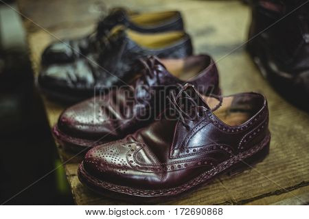 Pair of leather shoes in workshop