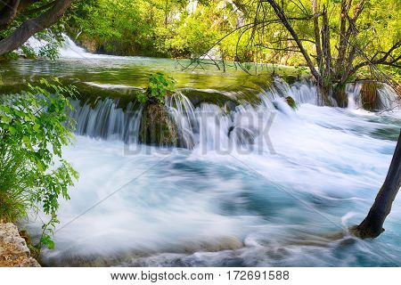 small beautiful waterfalls on slopes of mountains
