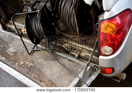 Detail with television camera cable roll in a trunk