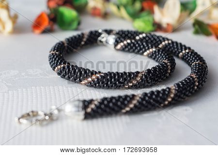 Handmade Beaded Necklace From Beads Of Black And Gold Color