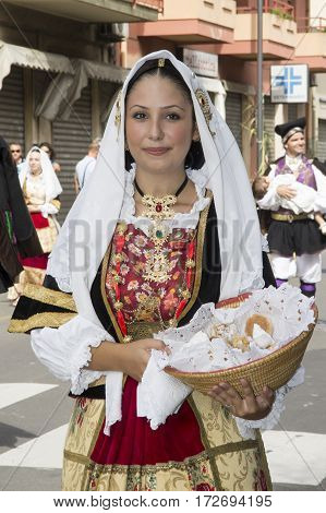 SELARGIUS, ITALY - September 8, 2013: Former marriage Selargino - portrait of a beautiful girl in the folk group Kellarious - Sardinia
