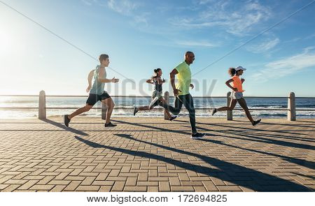 Young People Running Along Seaside