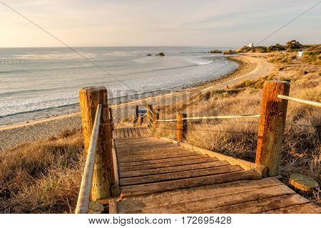 USA Pacific coast landscape, boardwalk to Leo Carrillo State Beach, Malibu, California.