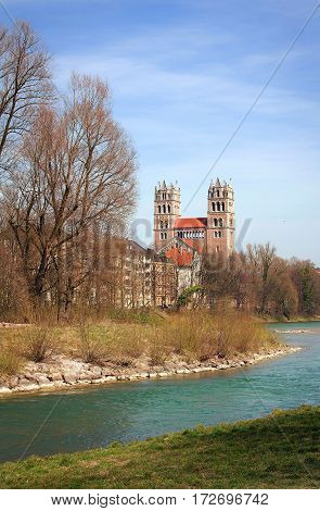 st maximilian church and isar river munich at early springtime