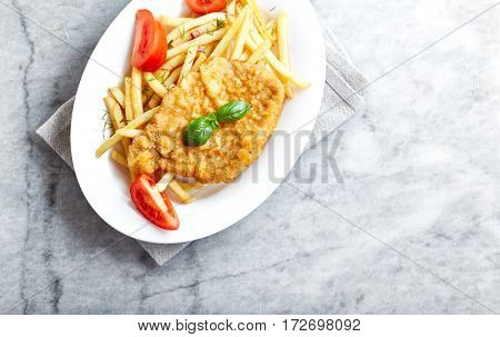 Schnitzel with french fries and tomatoes