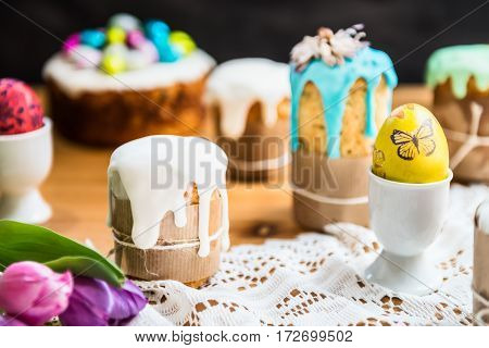 Festive Easter Table With Easter Cakes And Eggs