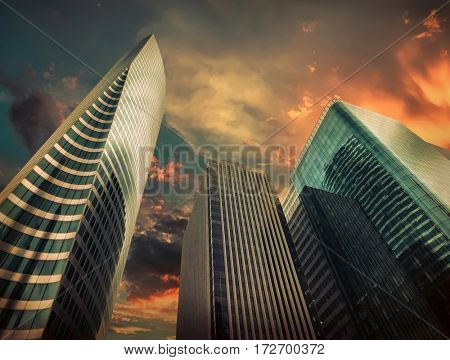 New modern business buildings under sky with clouds in Paris. Urban architecture skyscrapers under sun light at day.