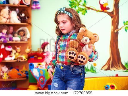 Cute Girl Playing With Toys In Kindergarten For Kids With Special Needs