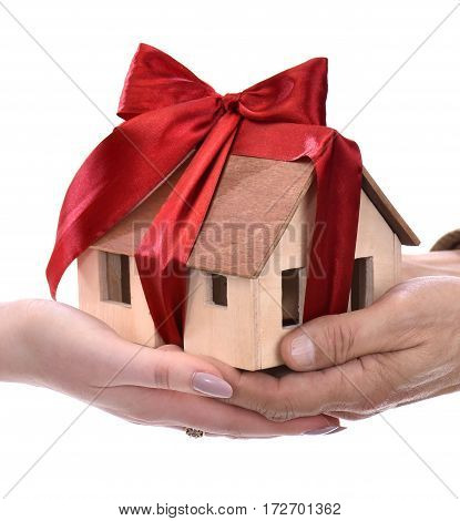 Man Giving Wooden House Model Tied With A Bow To Woman
