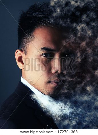Man face with pixel dispersion effect over a gray background