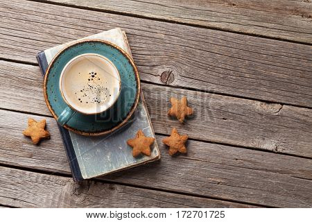 Coffee cup and cookies on wooden table. Top view with copy space